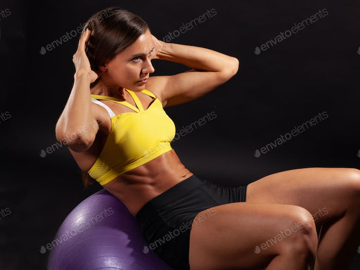 fitness female doing abs exercise in fitball