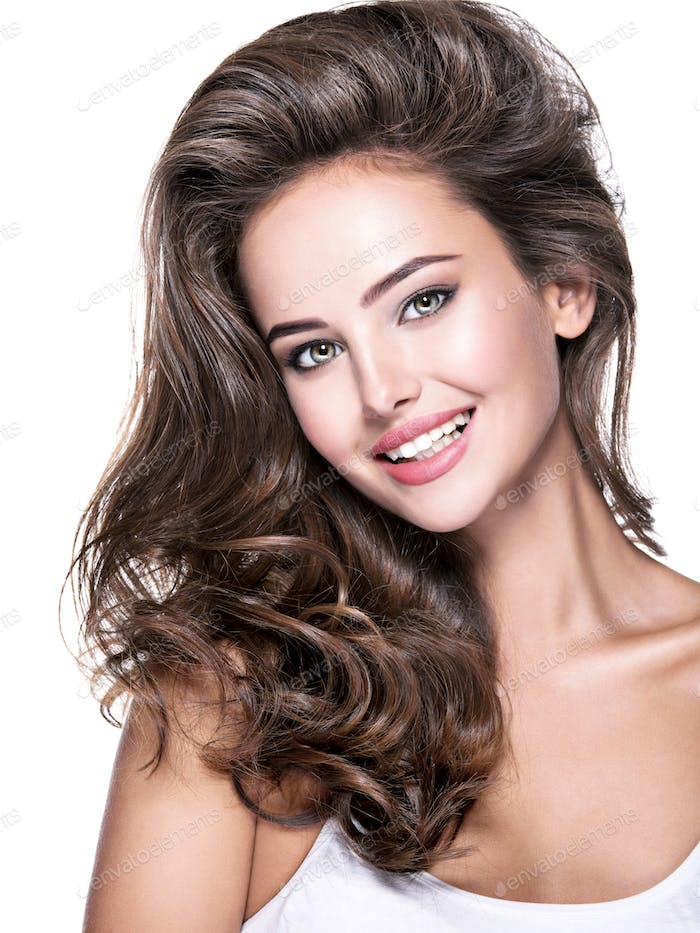 Beautiful smiling woman with long brown hair.