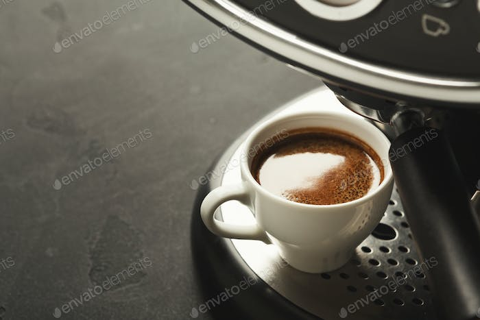 Brewing coffee in professional machine, closeup