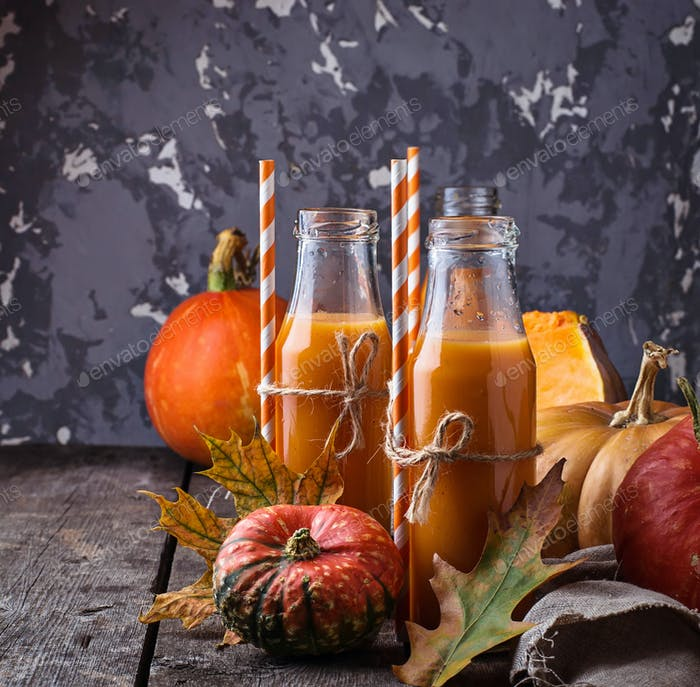 Bottles of healthy pumpkin juice