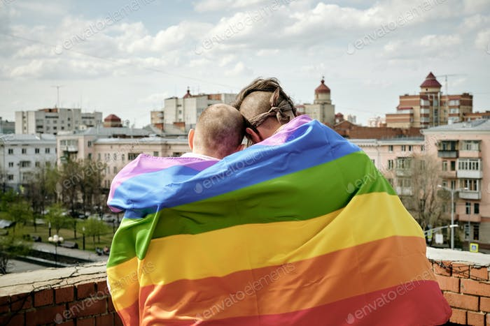 Gay Men Wrapped in Rainbow Flag