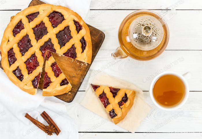 Pie with jam and tea. Morning breakfast.