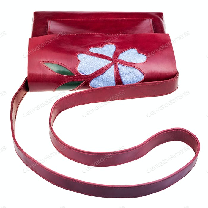 dark cherry color handbag decorated by flower