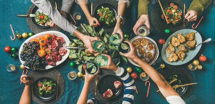 Company of friends or family celebrating Christmas together, top view
