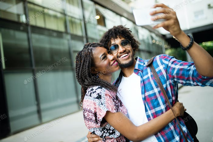 Couple happiness fun concept. Black young people embracing laughing on date