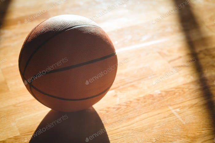 High angle view of orange basketball on floor