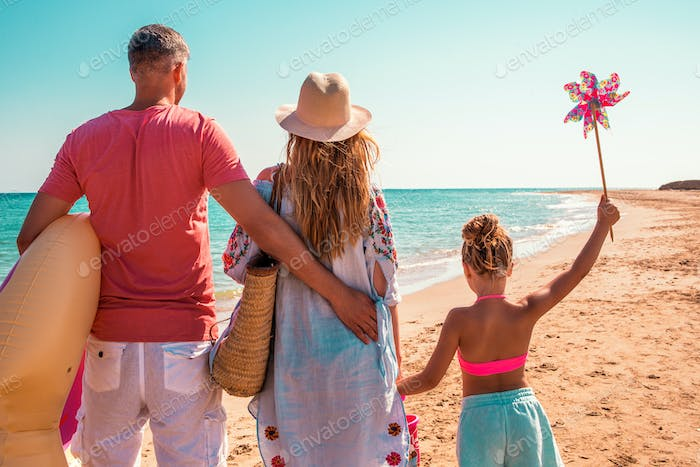 parents with child in summer