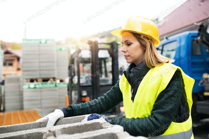 Young woman worker in an industrial area.