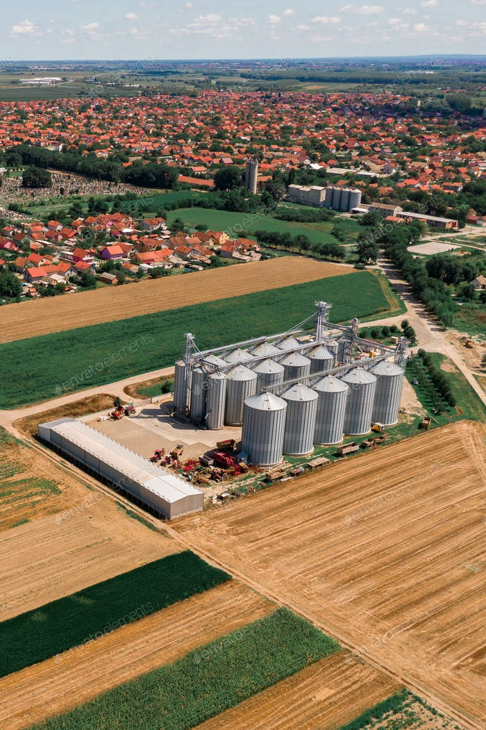 Aerial view of agricultural silo from drone pov
