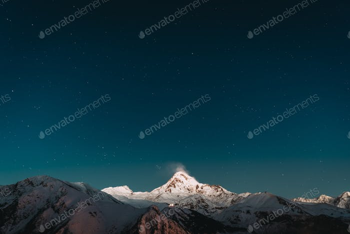 Georgia. Winter Night Starry Sky With Glowing Stars Over Peak Of