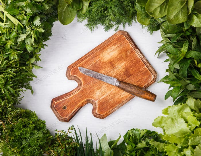 Various fresh herbs on a white background.Vegetarian concept.
