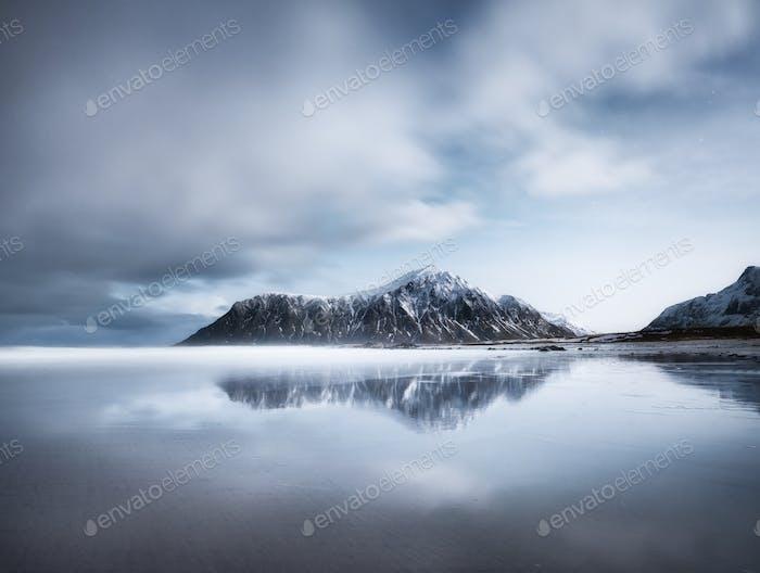 Skagsanden beach, Lofoten islands, Norway. Mountains, beach and clouds. Long exposure shot.
