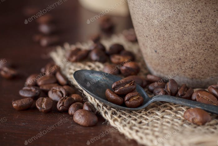 Coffee beans on table.