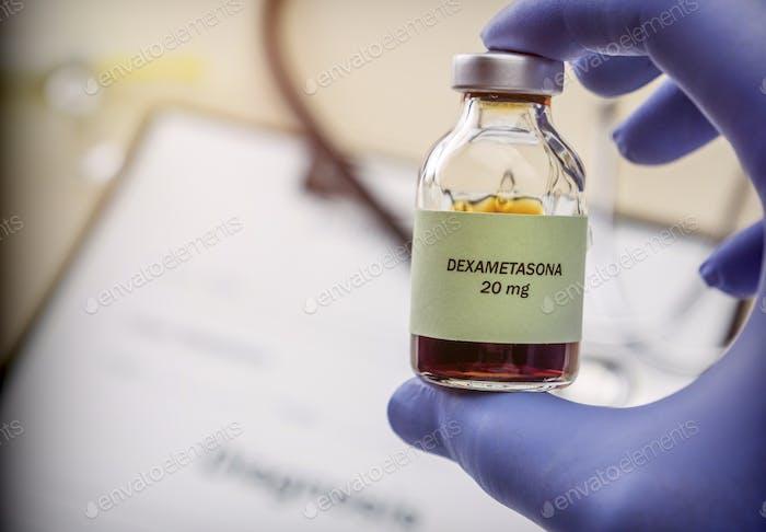 Doctor hold vial of dexametasona in a hospital. Conceptual image