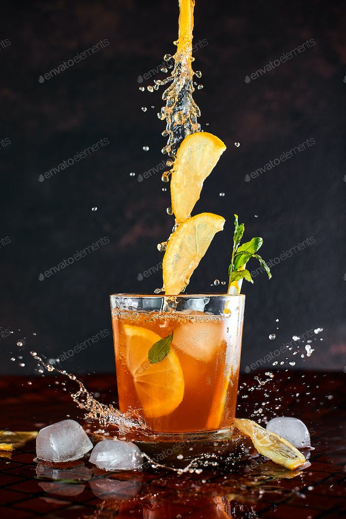 Iced lemon tea in motion concept.