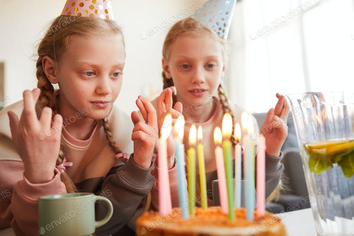 Little girls making wishes