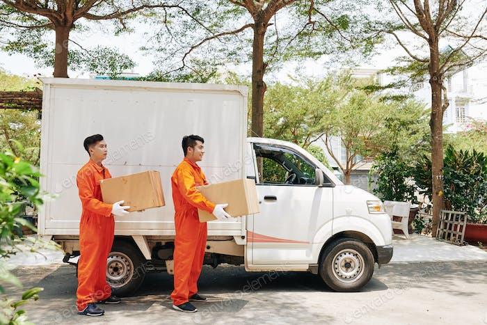 Two Men Delivering Boxes