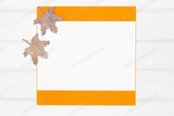Minimal flat lay autumn frame on white wooden board background