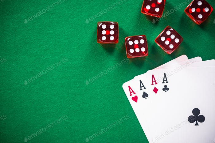 Four aces poker cards and red dices on casino table