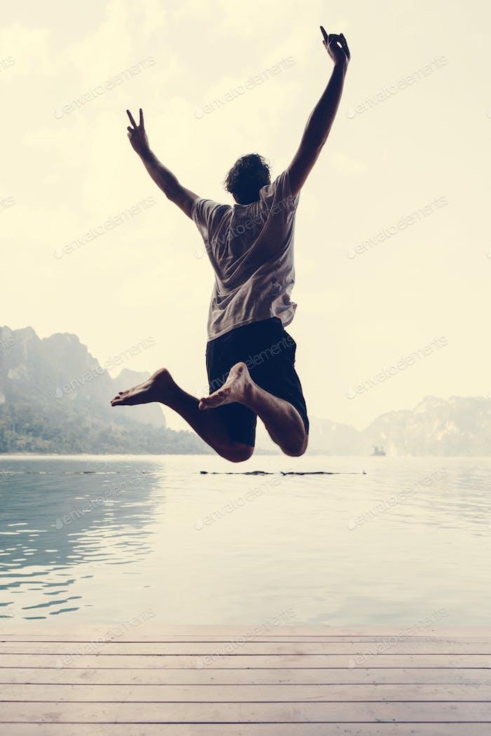 Happy man jumping with joy