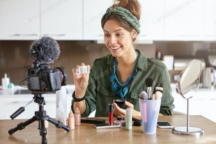 Beauty, cosmetics, e-commerce and blogging concept. Beautiful professional young female make up arti