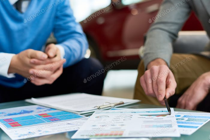 Business Experts Working at  Table