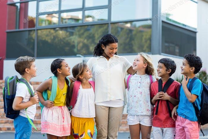 Cheerful female teacher with children