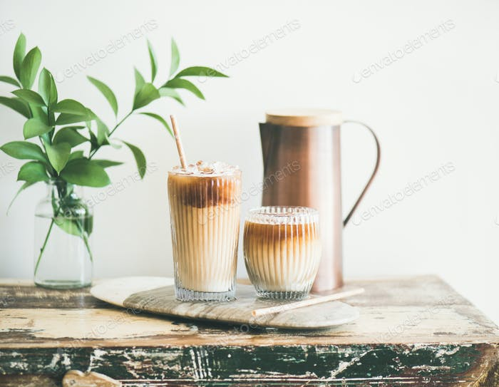 Iced coffee drink in tall glasses with milk, horizontal composition