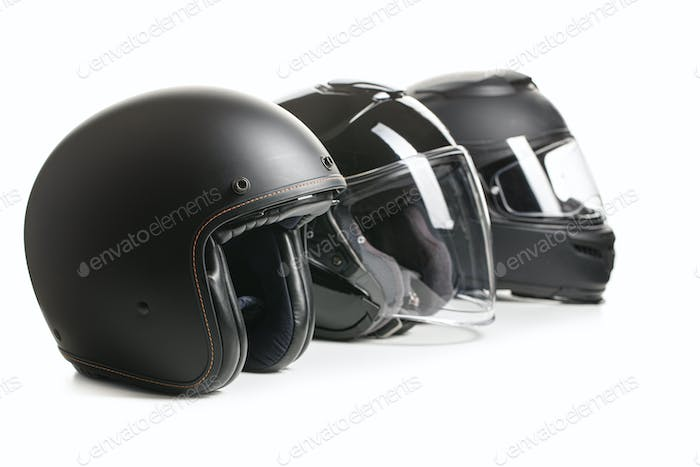 Three black motorcyle helmets