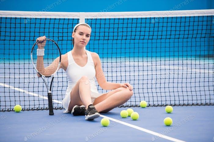 Confident Tennis Player in Court