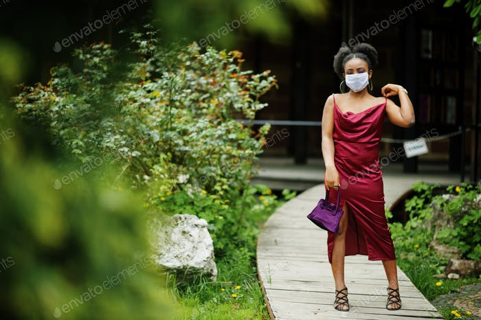 African woman wear medical disposable mask