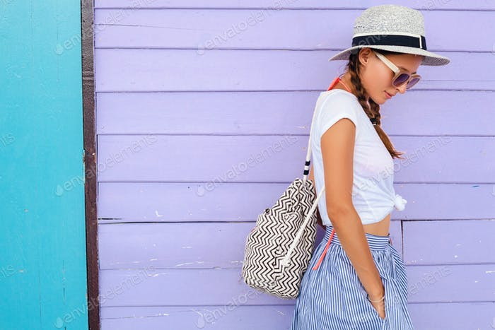 young beautiful woman in summer fashion outfit