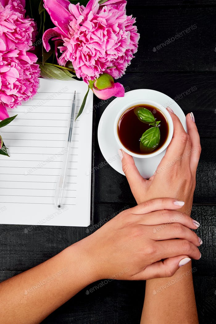 Woman hand writing diary with coffee