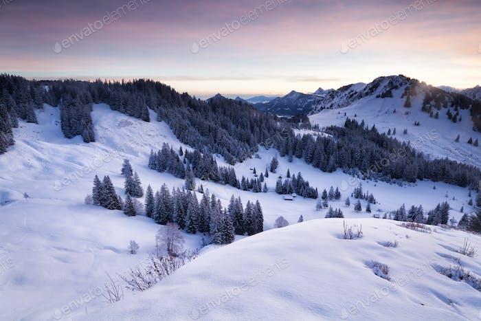 winter snowy mountains in dusk