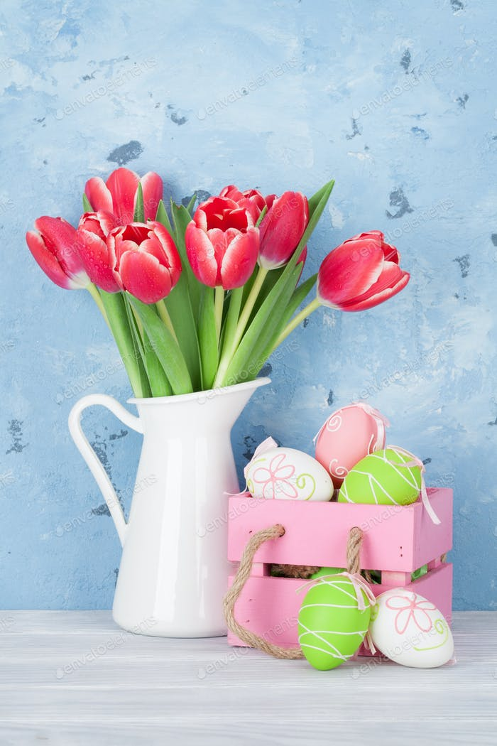 Red tulip flowers and easter eggs