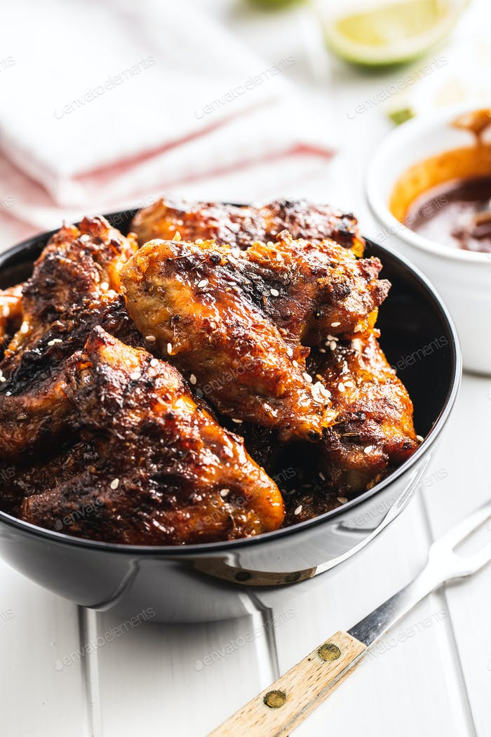 Grilled chicken wings in bowl.