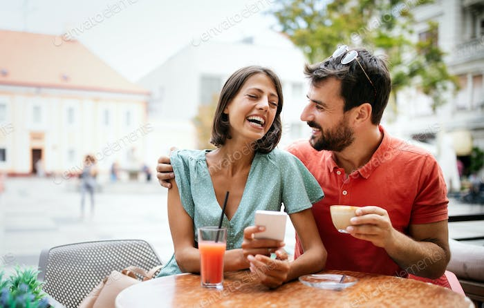 Cheerful young couple on a romantic date in a cafe