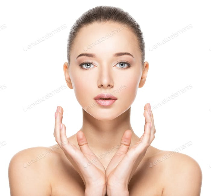 Young woman with healthy clean skin holds somthing