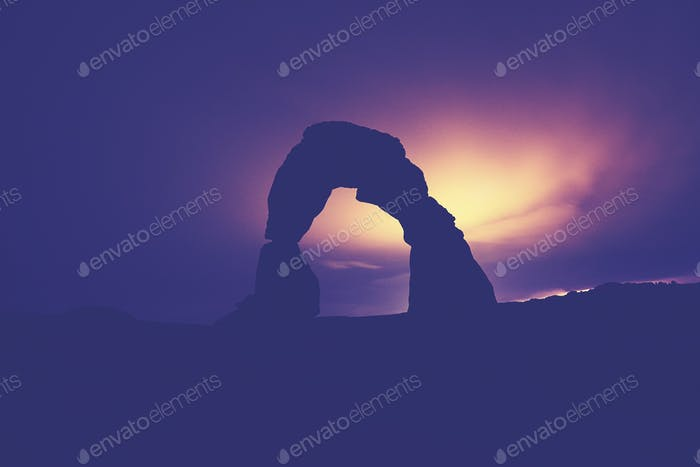 Moonlight backlit Delicate Arch silhouette, USA.