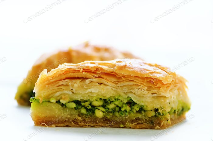 Baklava with pistachios, walnuts and honey on white background. Jewish, turkish, arabic traditional