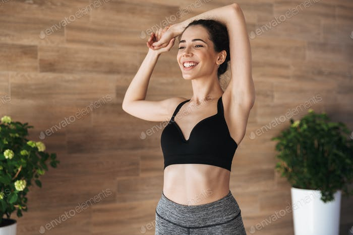 Portrait of a happy young sportswoman