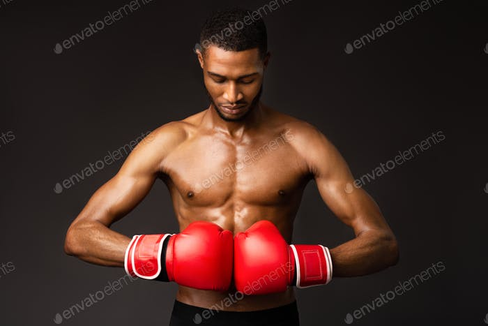 Handsome afro sportsman ready for fight at studio