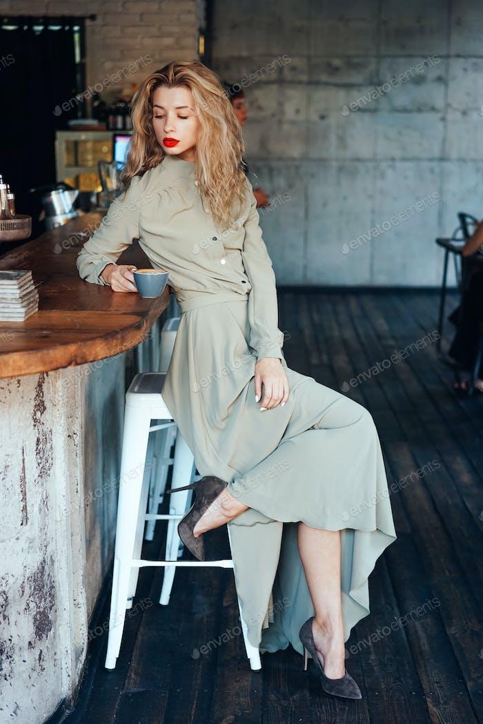 beautiful young girl in a long dress