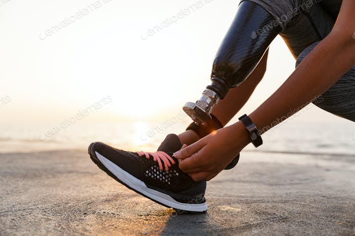 Close up of athlete woman with prosthetic leg