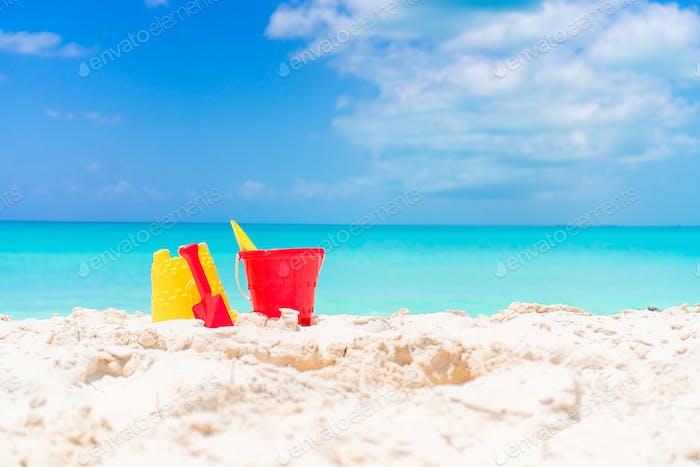 Beach kid's toys on white sand beach