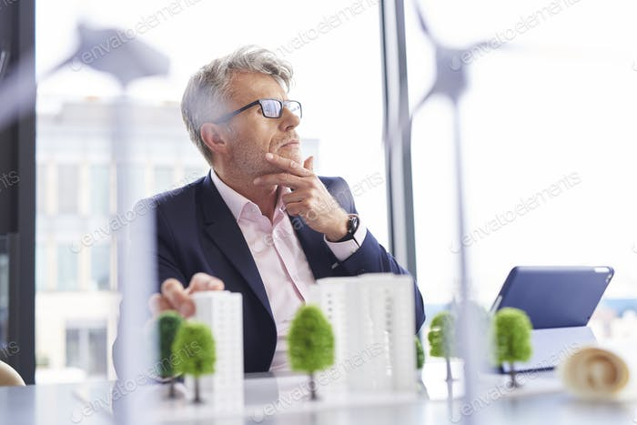 Busy businessman thinking about new solutions