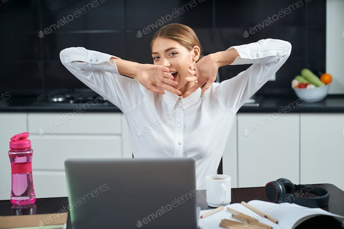 Woman feeling tired after remote work at home