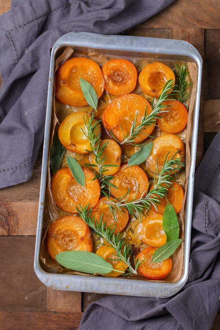 Baked apricots with honey, sage and rosemary leaves