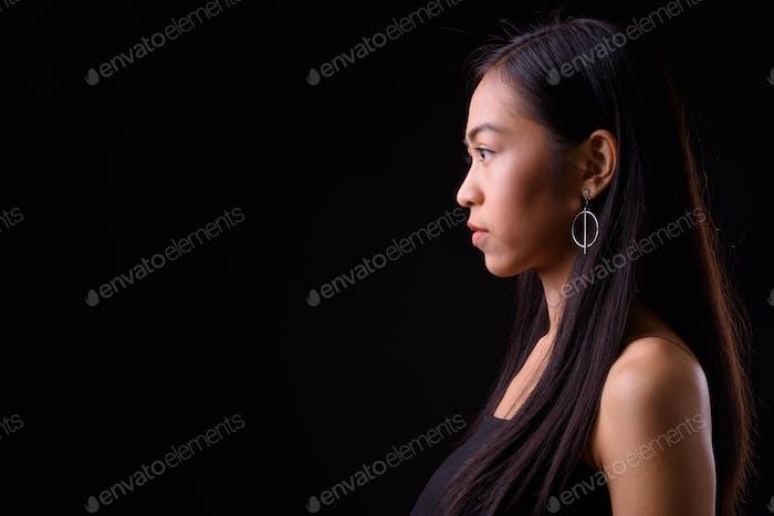 Closeup profile view of young beautiful Asian woman