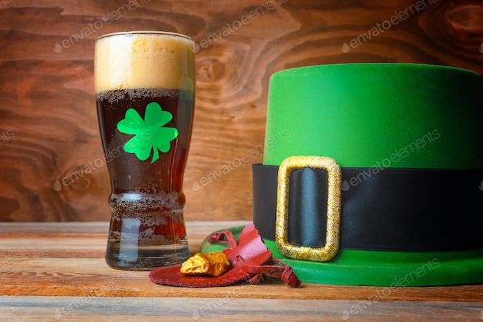 St.Patrick concept with green leprechaun hat, beer and gold